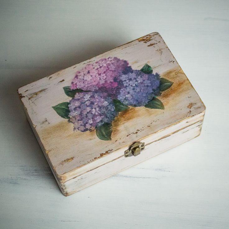 This wooden box with hand painted hydrangea is ideal for keeping your lovely jewels. The hand rubbed finish and the aged patina add a shabby chic touch to this lovingly handmade box.   Size:  22x16x8cm