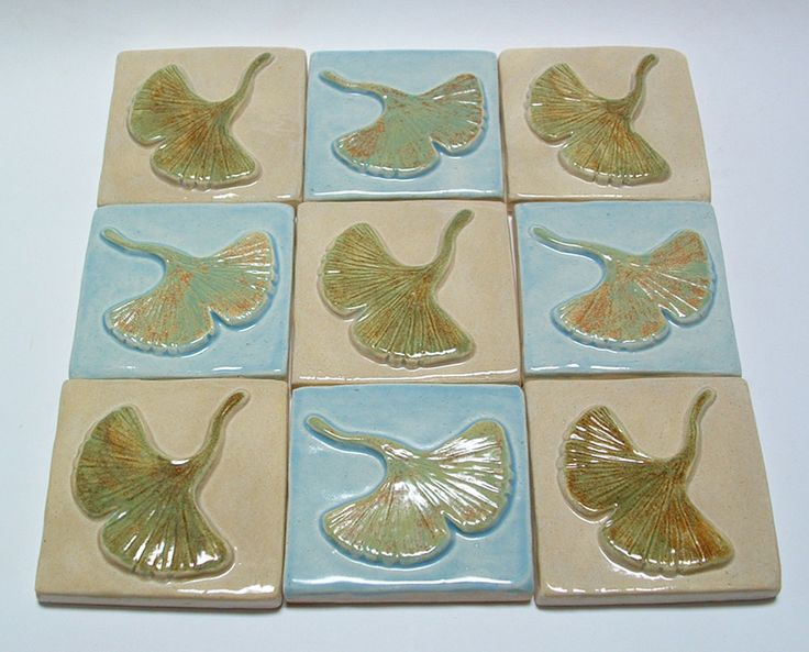 This is a focal point for a kitchen back-splash. It is made from nine, 3 inch gingko tile. So it makes a focal point measuring 9 x 9.  Tile  by Fay Jones day tile. buy them on etsy or at http://www.fayjonesdaytile.com