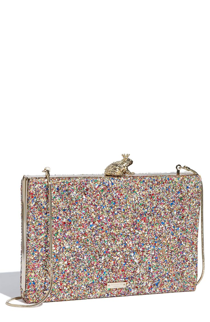 So cute! A sparkling box clutch encrusted with multicolored glitter and topped with a royal frog at the clasp.