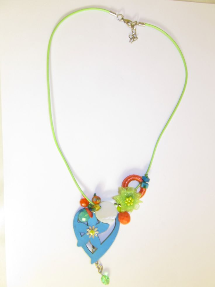 Handmade short leather necklace (1 pc)  Made with turquoise leather heart with metal flower, light green leather cord, fiber hoop, fabric flower, mother of pearl and glass beads.