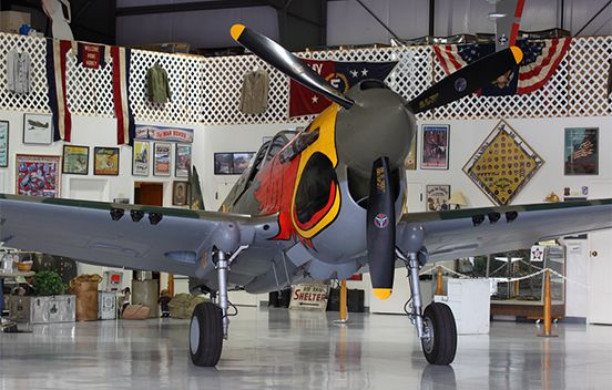 """The Warhawk Air Museum's Curtiss P-40N """"PARROT HEAD"""" was restored to flying condition in the 1980s and made it's first post-restoration flight in 1986. It competes at the Reno Air Races and was used in the filming of Michael Bay's 2001 motion picture Pearl Harbor."""
