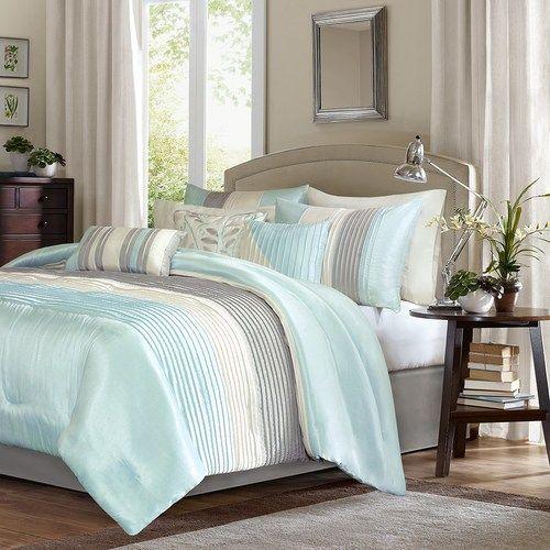The Oceanside Resort 7-piece King Size comforter set is a modern color blocked coastal bedding design in an elegant aqua and grey color palette.