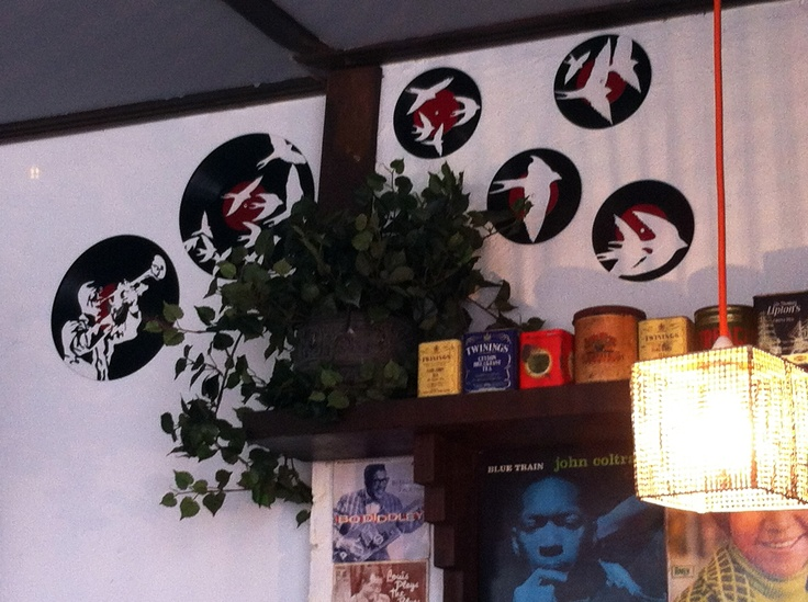 Painted records mixed in with climbing plants, vintage tea tins, succulents and Jazz covers