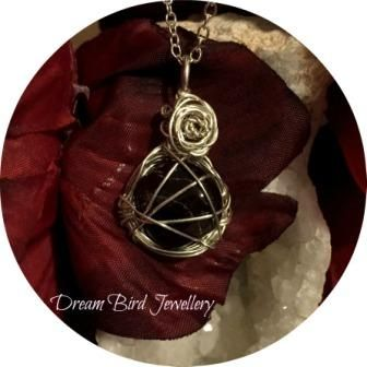 Designed and hand crafted by Dream Bird Jewellery this is a stunning one of a kind garnet necklace wirewrapped in sterling silver with a beautiful sterling silver rose to finish it off. This pendan...