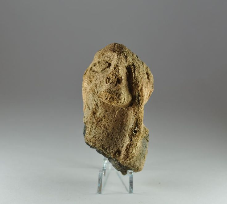 Thessalian terracotta figurine with hand covering one eye, 5th-4th millenium B.C. Thessalian pottery figure with right arm raised with hand covering one eye, 8.9 cm high. Private collection