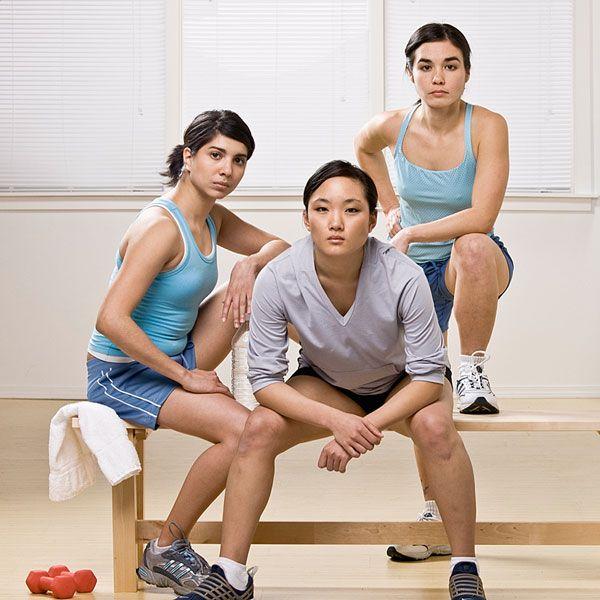 three athletes wearing sportswear