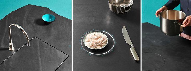 A cozinha Tuler esconde 4 placas de indução, balanças de cozinha, interruptor que aciona o aparecimento de uma pia e execução da água, e uma área de carregamento sem fio para celular ou tablet