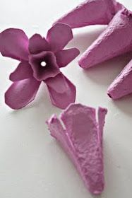This egg carton spring flower is so lovely.  Make one, or string a garland of them together and add sparkling lights for evening drama.