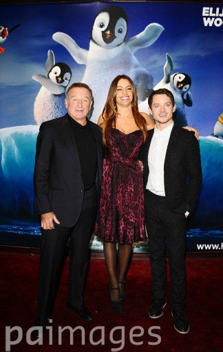 Left to right. Robin Williams, Sofia Vergara and Elijah Wood arrive at the premiere for Happy Feet Two at the Empire Cinema in London.