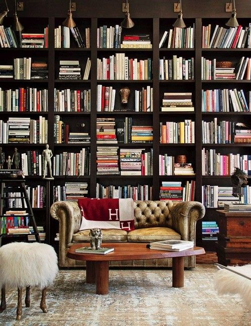 25 Stunning Home Libraries. Messagenote.com Wall sconces for comfortable book search, fur bench with animal legs, tufted leather sofa.