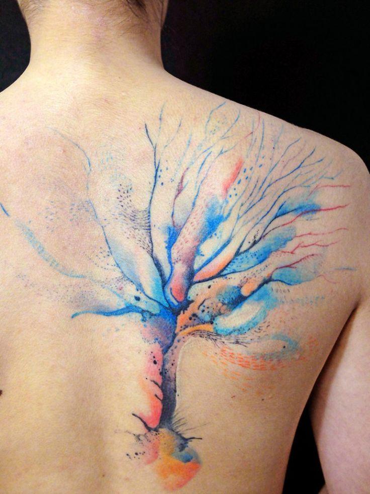 Fantastic Disney watercolor tattoo on upper back for girls - tree watercolor tattoo