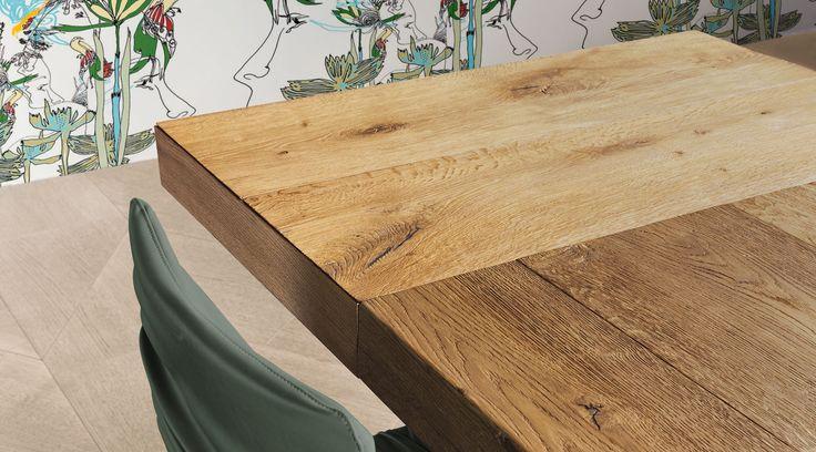 Il tavolo allungabile Air aggiunge fino a 4 posti a sedere in cucina: le prolunghe sono nascoste e possono essere in legno naturale Wildwood o laccato.