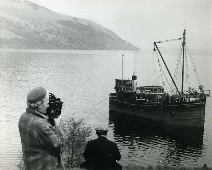 The first ever outside broadcast from the Highlands took place in 1959. The BBC programme featured the Clyde puffer, 'Kaffir', which is seen here searching for something in the waters of Loch Ness.