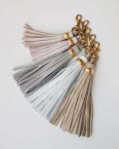 Large fluffy leather tassel to dress up all your accessories in desert inspired hues. Clip one to a purse, a keychain, a zipper, or anywhere