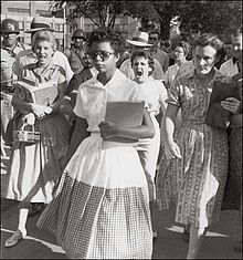 Elizabeth Eckford (born October 4, 1941) was one of the Little Rock Nine, a group of African-American students who, in 1957, were the first black students ever to attend classes at Little Rock Central High School in Little Rock, Arkansas. The integration came as a result of Brown v. Board of Education of Topeka. Her image was captured and shown around the world after photographer Will Counts snapped her being chased by an angry white mob down the street