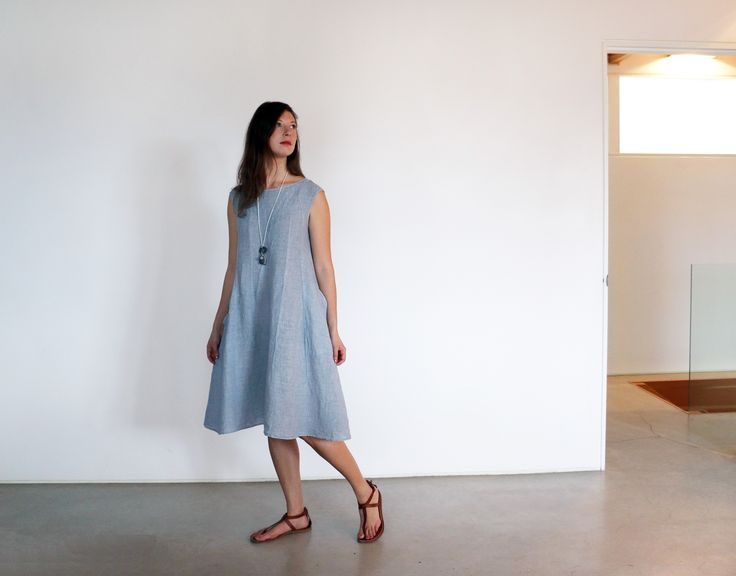 Pina Kingman in Manuelle Guibal linen mini tank dress Chika, Gianluca Sandles, and Effie Baker Designs necklace