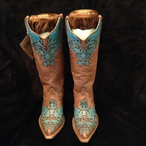 **BRAND NEW!** [[CORRAL VINTAGE BOOTS]] These are brand new never been worn Corral Vintage Boots. The color is sand with turquoise detailing. They also come with the boot savers with vinyl detail on top so you can keep the boots firm when not wearing them. I also have boot jewelry available to wrap around boot. If interested in that as well I will do a bundle. Corral Vintage Shoes