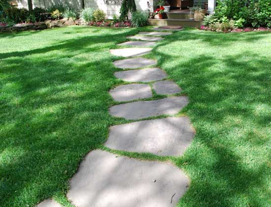 Paul 39 s next project flagstone path from one deck to the for Stone path in grass