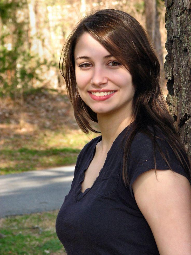 Beautiful Girl Posing In Park. Woman Looking At Camera
