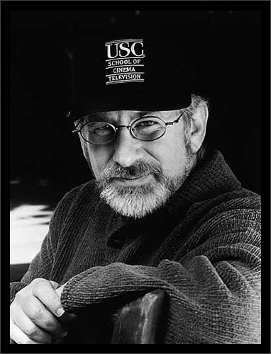 Steven Spielberg 1998. A few films he wrote, directed and/or produced: Jaws, Close Encounters of the Third Kind, Raiders of the Lost Ark franchise, E.T., The Color Purple, Empire of the Sun, Hook, Jurassic Park franchise, Schindler's List, Saving Private Ryan,  War of the Worlds, Lincoln, Poltergeist, Twilight Zone, Back to the Future franchise, The Color Purple, Empire of the Sun, Arachnophobia, Joe Versus the Volcano, Cape Fear, Men in Black franchise, Memoirs of a Geisha…
