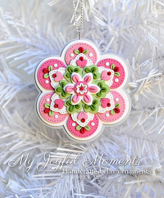 This is s one of a kind, handcrafted ornament made of durable polymer clay, with much attention given to detail and careful construction. No molds have been used, so you can be sure you are receiving a unique and one of a kind keepsake. This ornament measures approximately 3 3/8 inches wide by 3 1/2 inches tall not including the ribbon hanger. The item in the photo is the exact item you are purchasing and will receive, as I do not like to create the same thing twice :) This beautiful o...