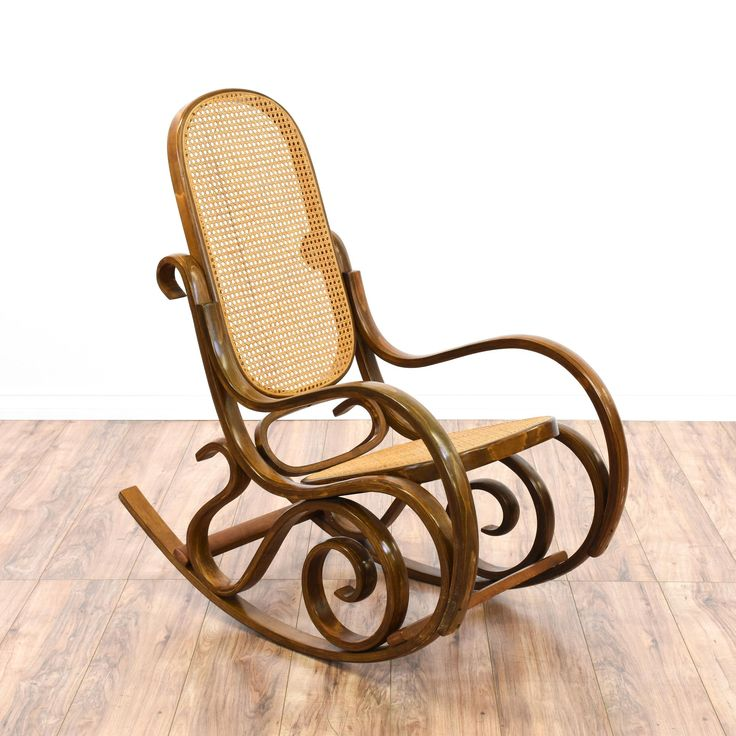 This bentwood rocker is featured in a curved wood with a glossy oak finish. This rocking chair has a woven cane back and seat, curved swirl details and a rocking base. Iconic chair perfect for a covered porch or patio! #bohemian #chairs #rockingchair #sandiegovintage #vintagefurniture