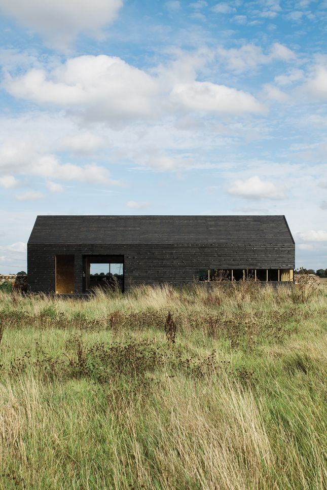 """""""It only cost about $48,000 to build, which was incredibly cheap,"""" says Turner of the Stealth Barn. """"We got the Timber Frame Company to supply the shell, then we clad it and fitted out the interior and windows ourselves. The idea was to take the archetypal black tar-painted agricultural building and make an almost childlike icon of that."""""""