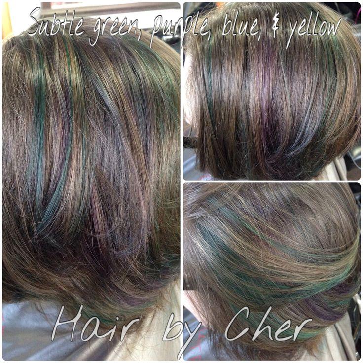 Very subtle oil spill/oil slick color on natural virgin hair. No pre-lightening or other hair color.