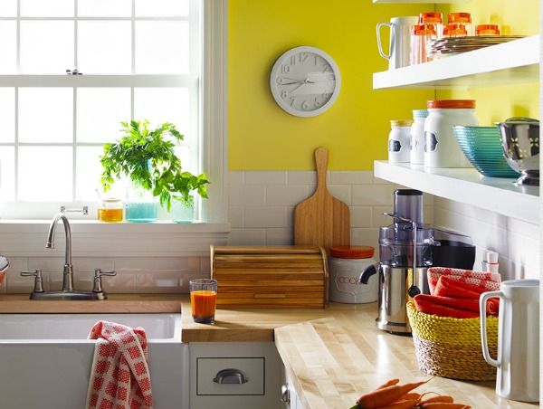 Yellow and Coral Kitchen - simple with pops of color and butcher block counter-tops.
