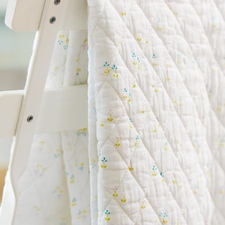 Super soft quilted voile in a delicate floral print make this baby blanket a favorite.