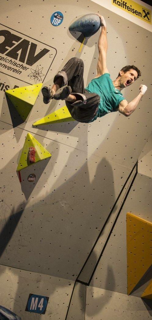 Rock star: Kilian Fischhuber celebrates winning the IFSC Boulder World Cup in Innsbruck. http://win.gs/1kfXEZd Image: David Robinson #bouldering #climbing #worldcup