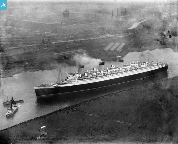 Queen Mary, River Clyde, Clydebank. Crowds on the river bank watch the first voyage of the newly build RMS Queen Mary. March 1936