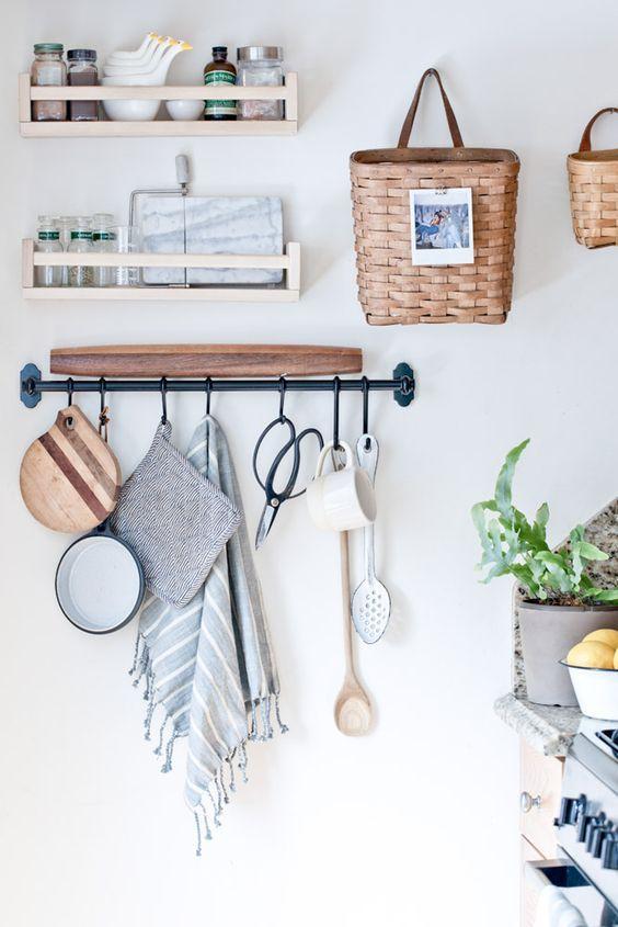 baskets on hooks and a metal rod