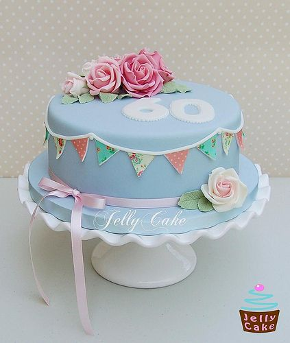 A Cath Kidston inspired 60th Birthday Cake. Pink and white sugar roses with sugar bunting.