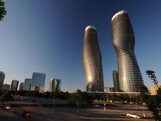 Marylin Monroe Towers in Toronto area, Canada. An Agilia® concrete realization.  Ignus Gerber - Burka Varacelli Architects , MAD Architectural Design Studio