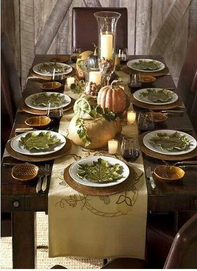 """Beautiful """"leaf"""" salad plates, layered on dinner plates, with chargers and table runner."""