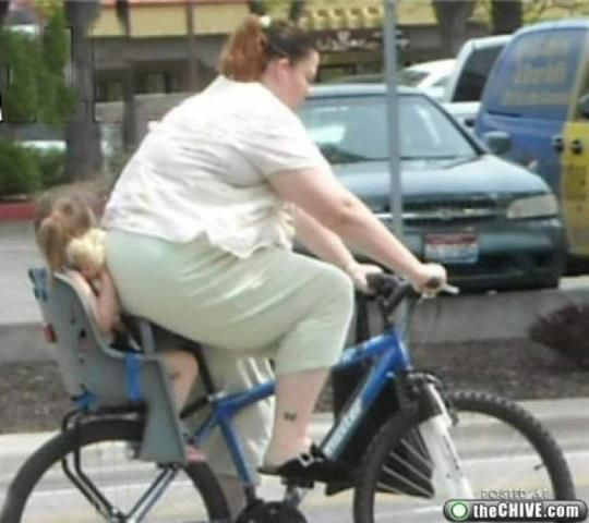 Poor kid on the back of a bicycle
