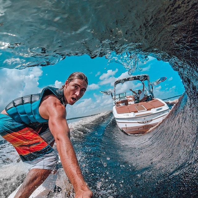 Photo of the Day! @collinharrington catching a fresh water #tube from the inside out, thanks to @parxxx in the boat. #GoPro #Surf