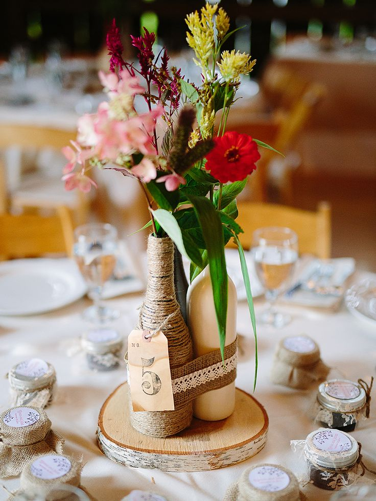 Wine bottle centerpieces for a rustic wedding reception