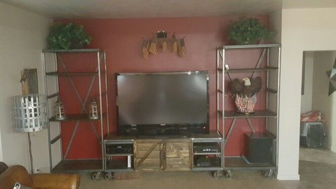 Tv stand with barn doors and 2 -7 foot tall book shelves ..