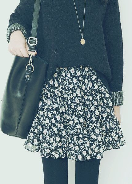 loose jumper, long necklace, floral flippy skirt, tights and black leather bag with longer strap