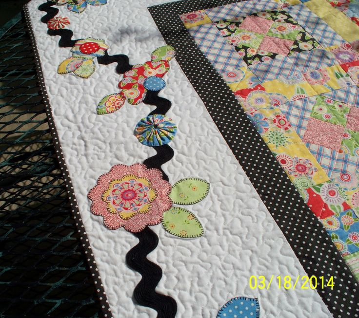 Charming quilt with Mary Engelbreit fabric... love the ric rack vine