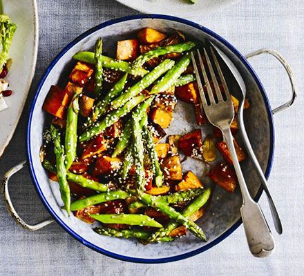 Roasted sesame sweet potatoes & asparagus. Flavoured with Thai fish sauce, soy, ginger and garlic, this Asian-inspired dish makes a great accompaniment to meat, fish and tofu recipes