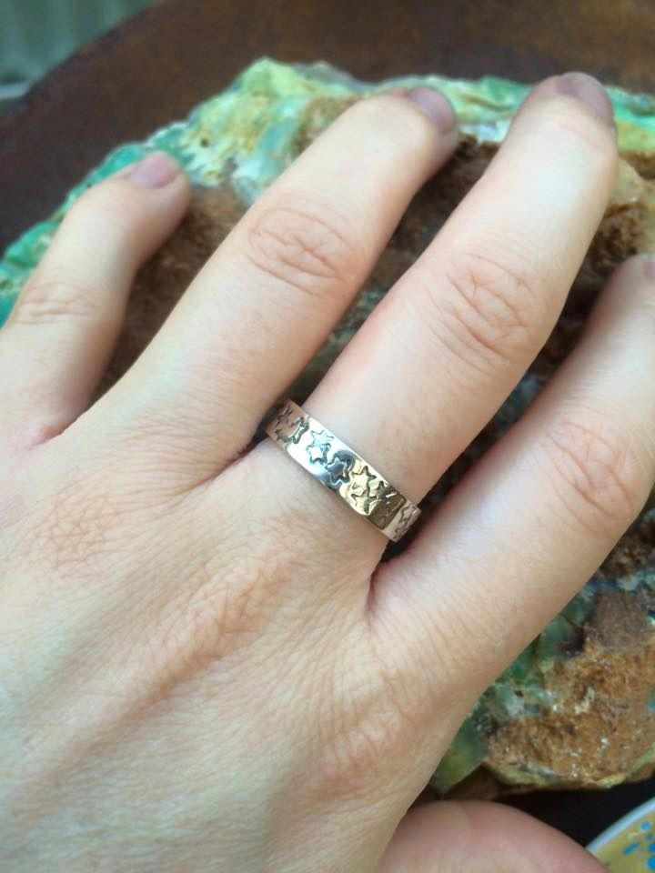 this ring is made from 925 recycled silver, 5mm wide band stamped with stars  can be stamped with a message on the inside of ring on request as these are made to order available in all sizes, also availble in a 3mm band see starlight stacker ring