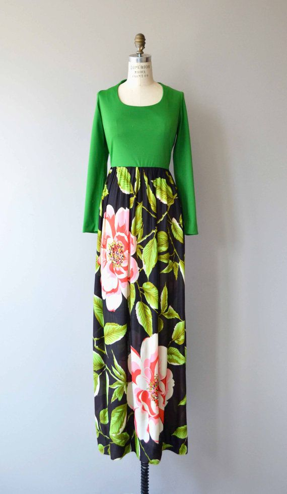 Gorgeous vintage 1970s polyester jersey maxi dress with bright green scoopneck bodice, fitted waist, long bold floral skirt and back zip closure. --- M E A S U R E M E N T S ---  fits like: medium shoulder: 15.5 bust: 36-38 waist: 30 hip: up to 44 shoulder to waist: 14.5 length: 58 brand/maker: n/a condition: excellent  ✩ layaway is available for this item  To ensure a good fit, please read the sizing guide: http://www.etsy.com/shop/DearGolden/policy  ✩ more...