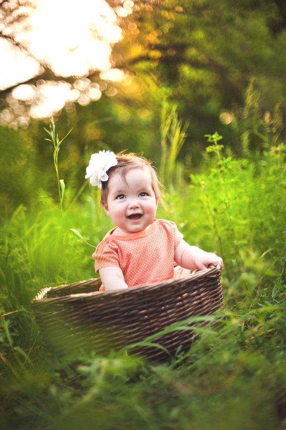 Put a little girl with a headband in a basket in the middle of a field and you get perfection!