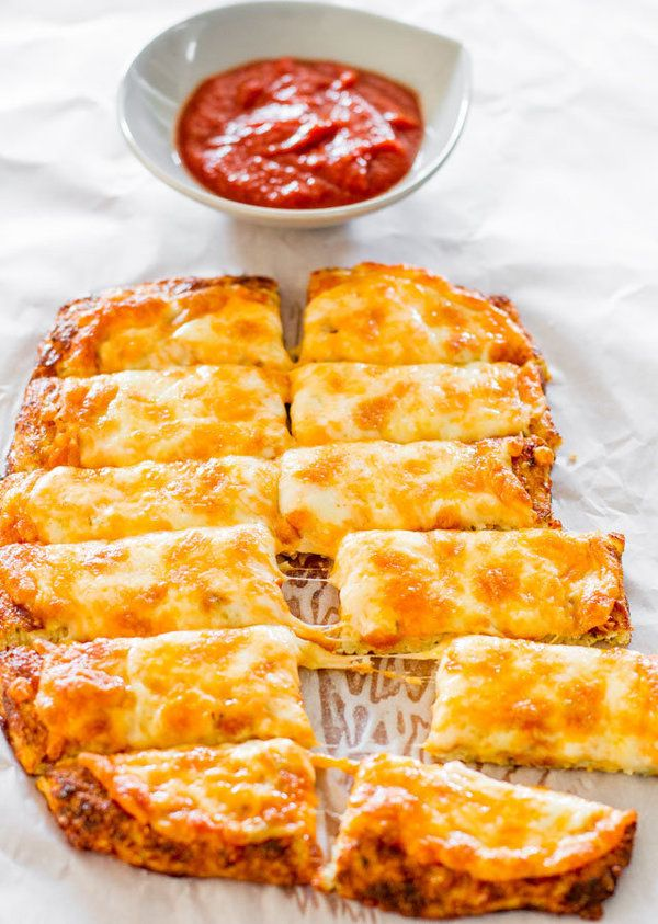 """<strong>Get the <a href=""""http://www.jocooks.com/healthy-eating/cheesy-cauliflower-breadsticks/"""" target=""""_blank"""">Cheesy Cauliflower Breadsticks recipe</a> from Jo Cooks</strong>"""