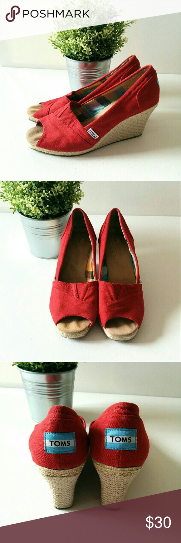Toms Wedges Red Toms wedge shoe. Good condition, wear on sole and one visible scuff as pictured. TOMS Shoes
