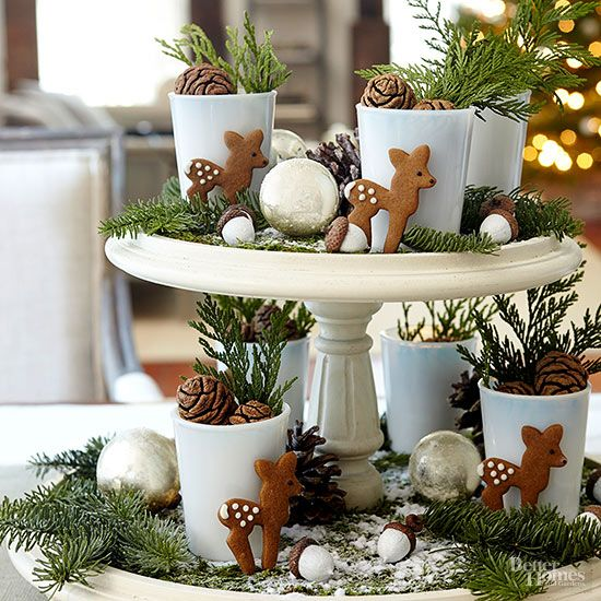 This double-decker idea starts with cute gingerbread cutouts. We chose a deer pattern. Carefully arrange the cookies with cut greens, pinecones, and Christmas ornaments. It's almost too cute to eat!/