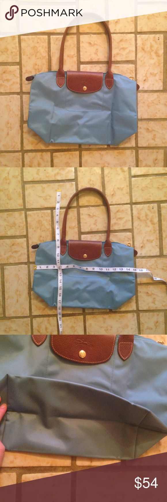 Longchamp Bag This bag is perfect for everyday use! It is in excellent condition, with just one mark on the inside and some very light wear as shown. It is bright blue in person, and measurements can be seen in the pictures. Please let me know if you have any questions! Bundle with my other items for a good deal. Thanks for looking 😊 Longchamp Bags Shoulder Bags